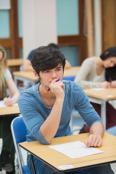 Estudante pensando exame ouvir faculdade Foto stock © wavebreak_media