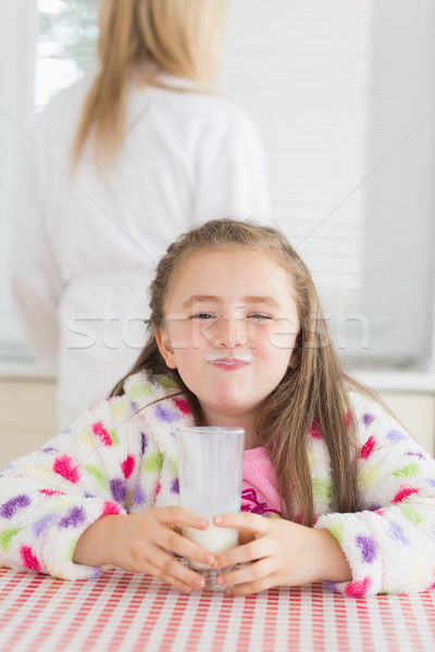 Little girl with milk moustache after drinking glass of milk Stock photo © wavebreak_media