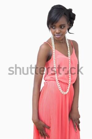 Kadın poz dizi inciler pembe elbise Stok fotoğraf © wavebreak_media