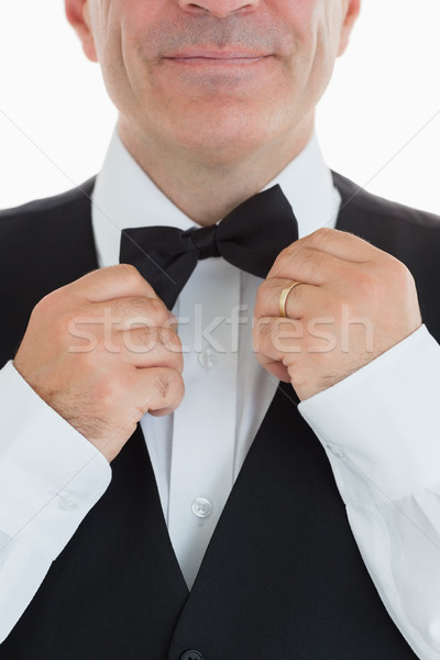 Smiling waiter adjusting his bow tie Stock photo © wavebreak_media