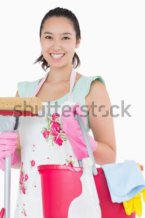 Portrait of young maid with cooking utensil Stock photo © wavebreak_media