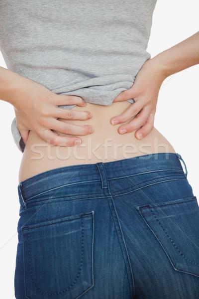 Mulher ruim dor nas costas branco jeans Foto stock © wavebreak_media