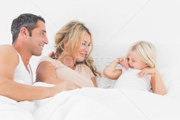 Ouders naar dochter bed omhoog man Stockfoto © wavebreak_media