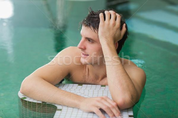 Adam rahatlatıcı yüzme havuzu yakışıklı adam su mutlu Stok fotoğraf © wavebreak_media