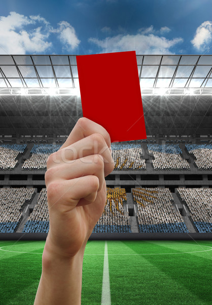 Composite image of hand holding up red card Stock photo © wavebreak_media