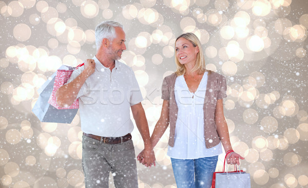Composite image of happy couple with shopping bags Stock photo © wavebreak_media