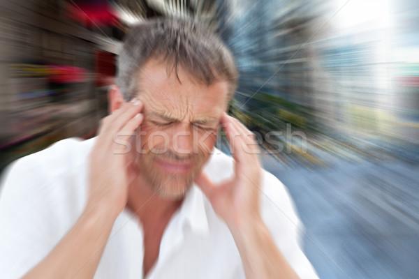 Composite image of man with headache Stock photo © wavebreak_media