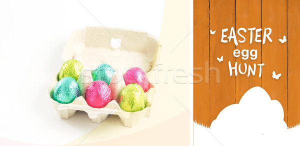 Composite image of easter  egg hunt graphic Stock photo © wavebreak_media