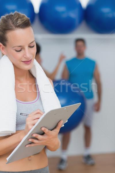 トレーナー 書く クリップボード フィットネス クラス 女性 ストックフォト © wavebreak_media