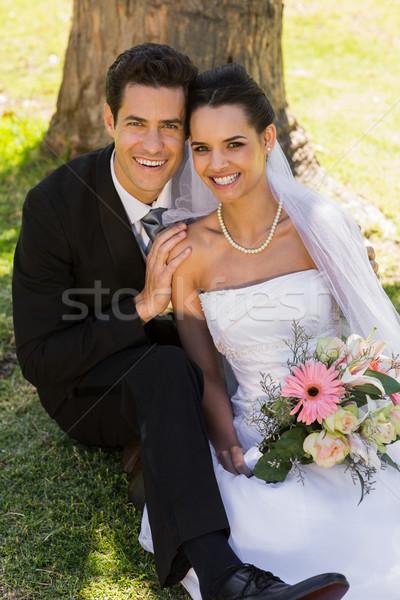 Yeni evli çift oturma park portre Stok fotoğraf © wavebreak_media