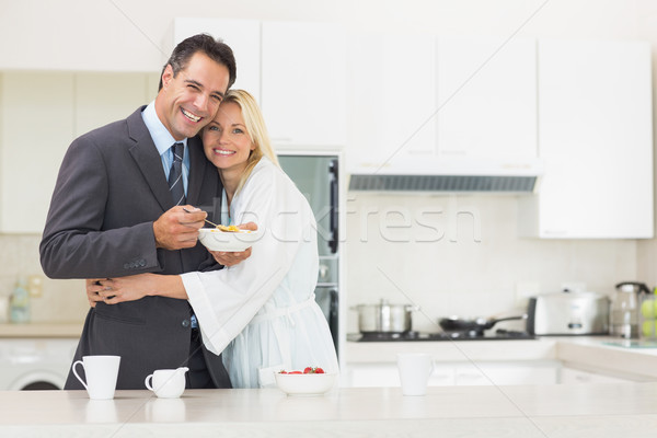 Woman embracing well dressed man in the kitchen Stock photo © wavebreak_media