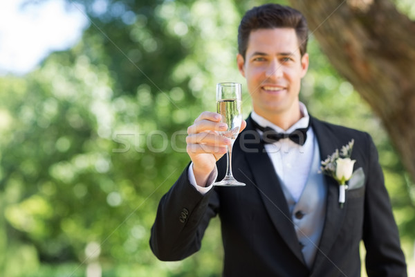 Smiling groom holding champagne flute in garden Stock photo © wavebreak_media
