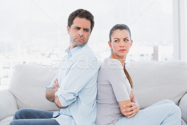 Angry couple sitting back-to-back on the couch Stock photo © wavebreak_media