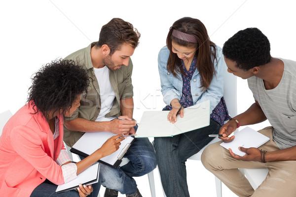 Csoport lezser fiatalok megbeszélés fehér dolgozik Stock fotó © wavebreak_media