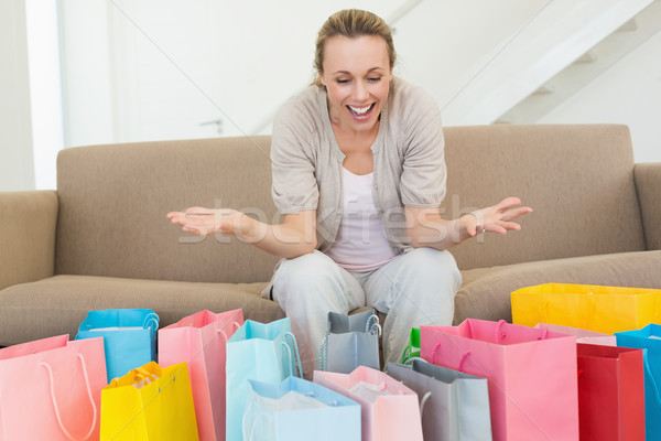 興奮した 女性 見える 多くの ショッピングバッグ ホーム ストックフォト © wavebreak_media