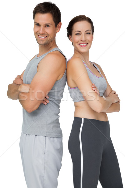 Portrait of a happy fit couple with hands crossed Stock photo © wavebreak_media