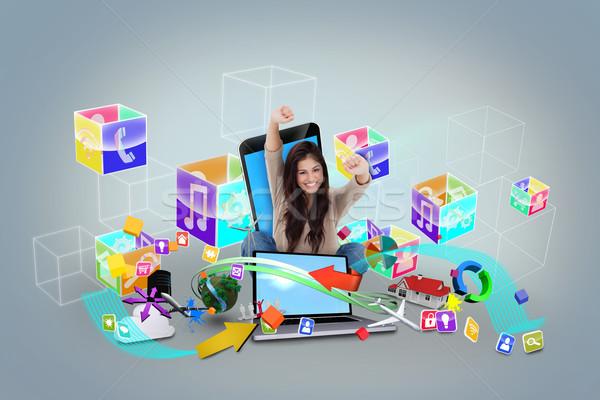 Cheering girl using laptop with app icons Stock photo © wavebreak_media