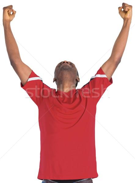 Excited handsome football fan cheering Stock photo © wavebreak_media