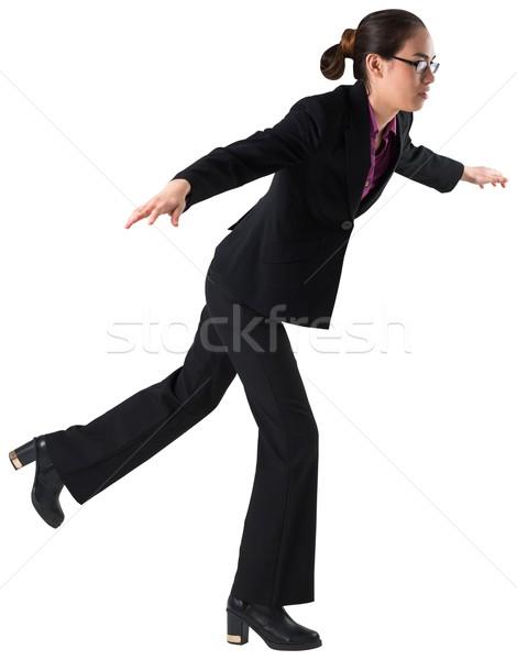Businesswoman stepping and balancing Stock photo © wavebreak_media
