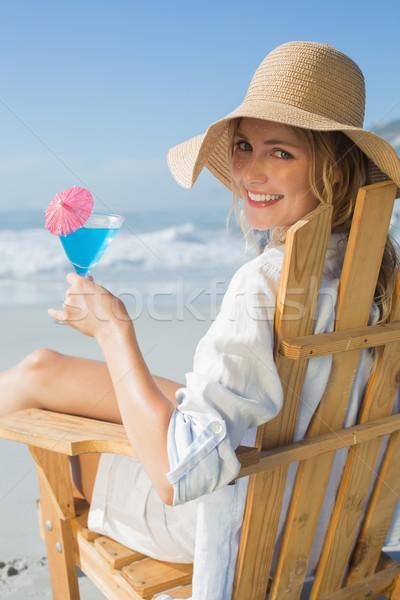Sonriendo relajante cubierta silla mar Foto stock © wavebreak_media