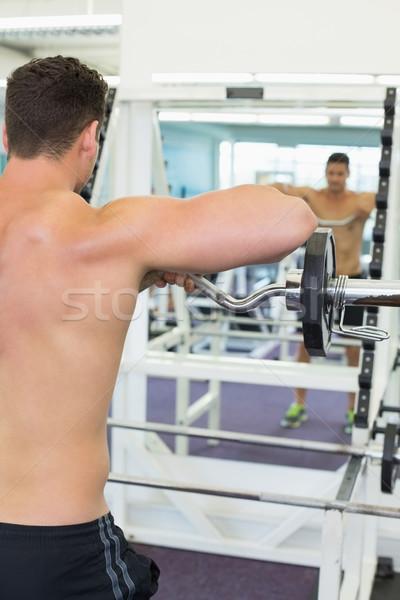 Sin camisa centrado pesado barra con pesas Foto stock © wavebreak_media
