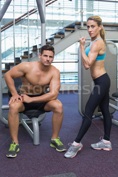 Bodybuilding man vrouw poseren camera gymnasium Stockfoto © wavebreak_media
