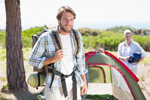 Séduisant homme souriant caméra partenaire tente Photo stock © wavebreak_media