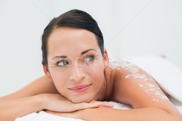 Peaceful brunette lying with salt scrub on back Stock photo © wavebreak_media