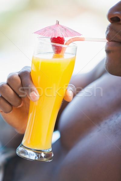 Sin camisa hombre potable naranja cóctel Foto stock © wavebreak_media
