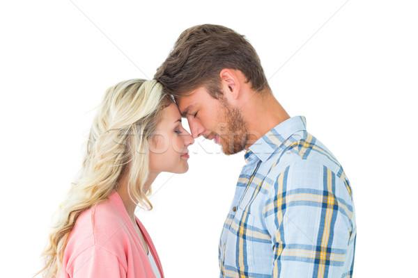Attractive couple standing touching heads Stock photo © wavebreak_media