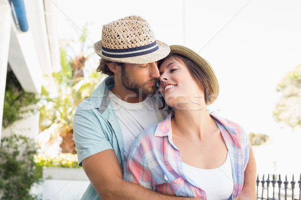 Happy couple standing and hugging Stock photo © wavebreak_media