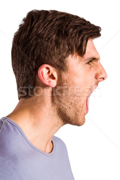 Angry young man with stubble shouting  Stock photo © wavebreak_media