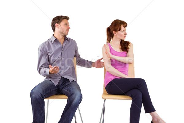 Séance couple argument blanche homme lutte Photo stock © wavebreak_media