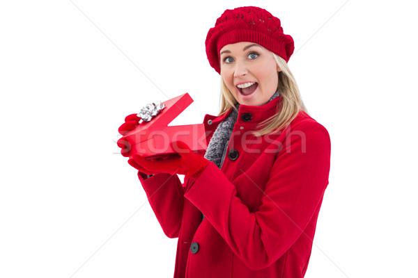 ünnepi szőke nő tart piros ajándék fehér Stock fotó © wavebreak_media