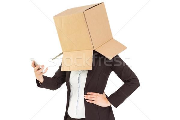 Anonim üzletasszony küldés szöveg fehér doboz Stock fotó © wavebreak_media