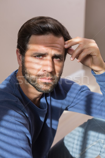 Depressed man sitting on floor Stock photo © wavebreak_media