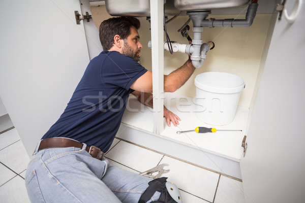 Plumber fixing under the sink Stock photo © wavebreak_media