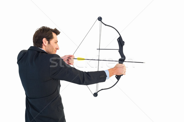 Businessman shooting bow and arrow Stock photo © wavebreak_media