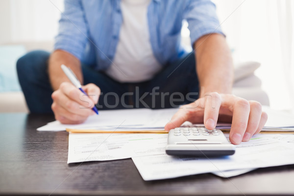 Focused man figuring out his finances Stock photo © wavebreak_media
