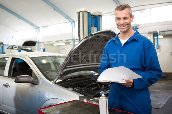 механиком Дать буфер обмена ремонта гаража человека Сток-фото © wavebreak_media