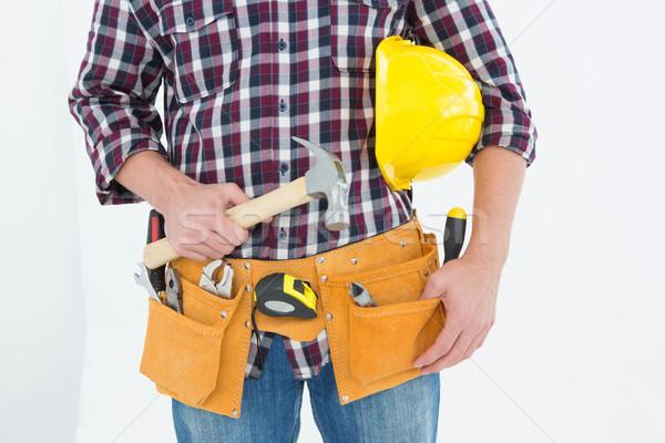 Szerelő védősisak kalapács kép férfi fehér Stock fotó © wavebreak_media