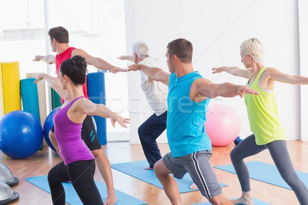 Mensen krijger pose yoga klasse geschikt Stockfoto © wavebreak_media