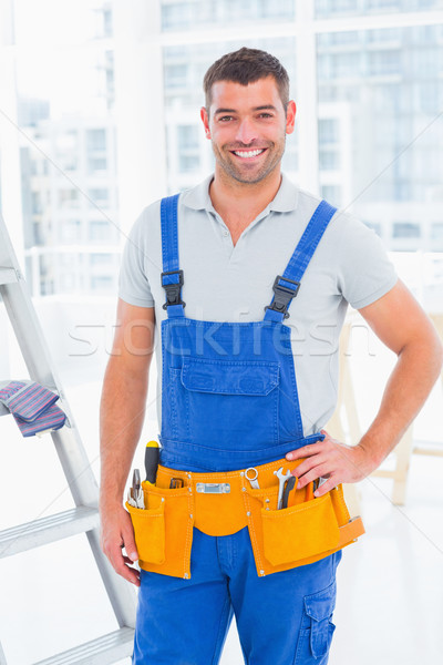 Handyman in overalls at modern office Stock photo © wavebreak_media
