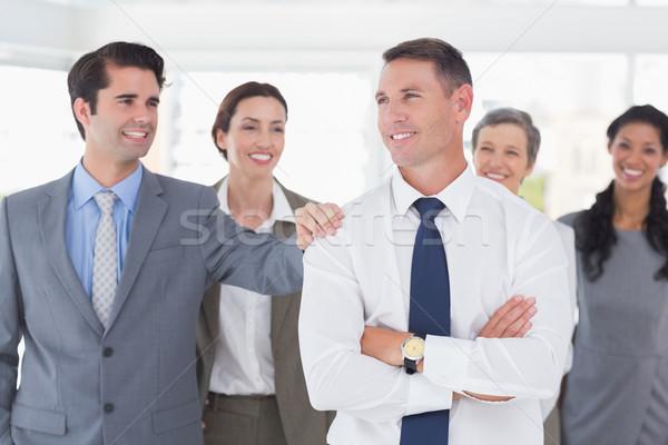 Business people congratulating their colleague Stock photo © wavebreak_media
