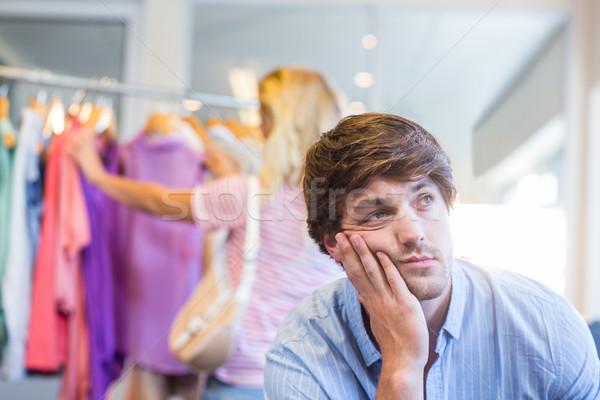 Boldog szőke nő vásárlás kimerült fiúbarát ruházat Stock fotó © wavebreak_media