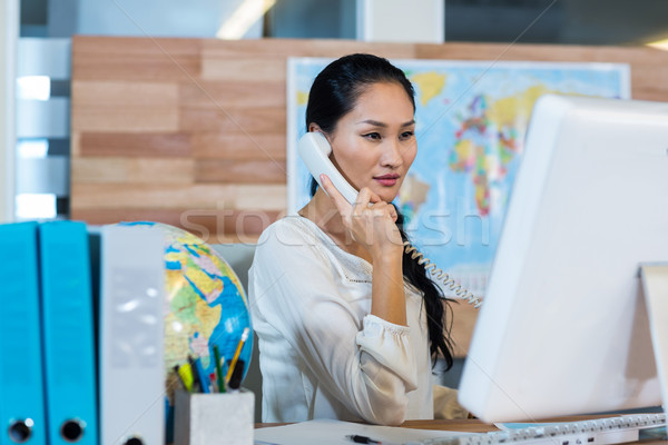 Stock photo: Pretty businesswoman having phone call