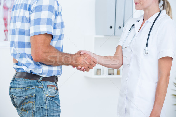Patiënt handen schudden arts medische kantoor man Stockfoto © wavebreak_media