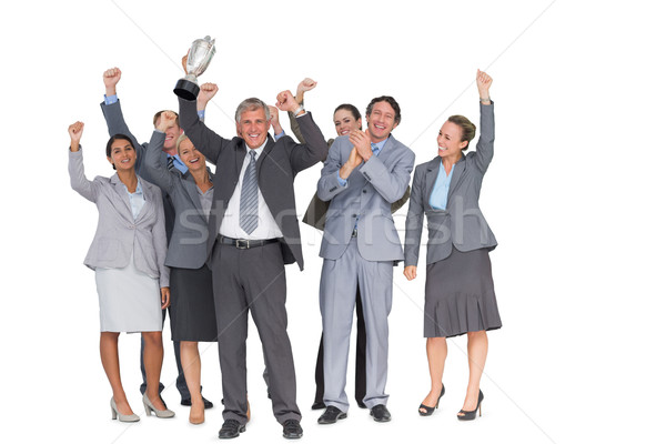 Excited business team cheering at camera with trophy Stock photo © wavebreak_media