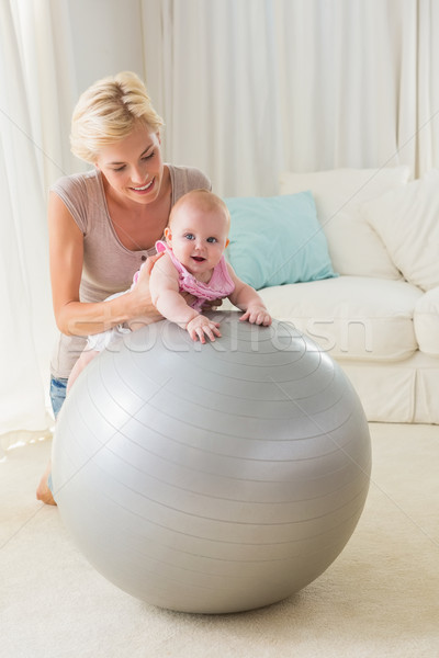 Happy mother with her baby girl in the exercice ball  Stock photo © wavebreak_media