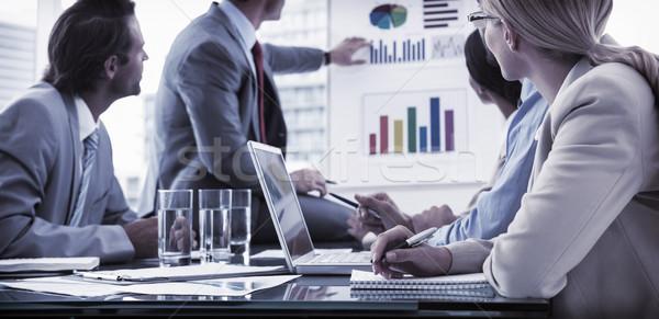 Young business people in board room meeting Stock photo © wavebreak_media